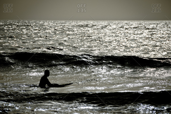 Man with surfboard in Moroccan sea