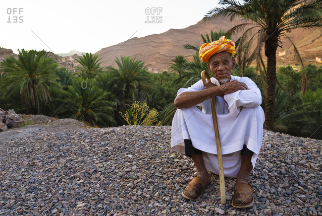 Morocco - August 13, 2010: Old man sitting in Ameln Valley, Morocco