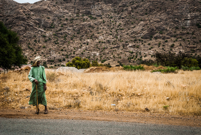Morocco - August 15, 2010: Old man standing on road in Ameln Valley, Morocco