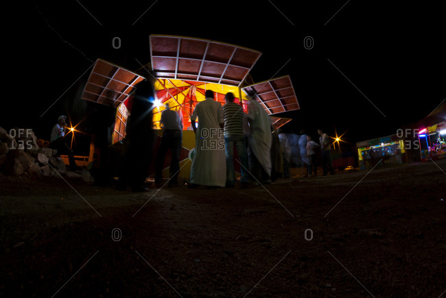 Men at outdoor stall at night in Morocco
