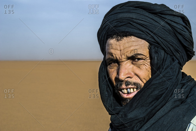 Morocco - August 17, 2010: Portrait of Berber man in Moroccan desert