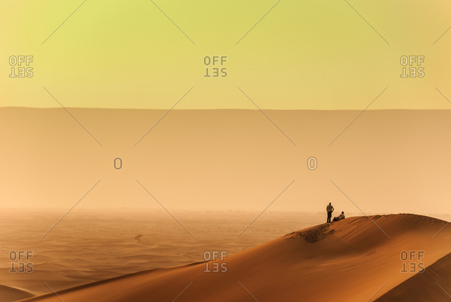 Person walking along Moroccan desert