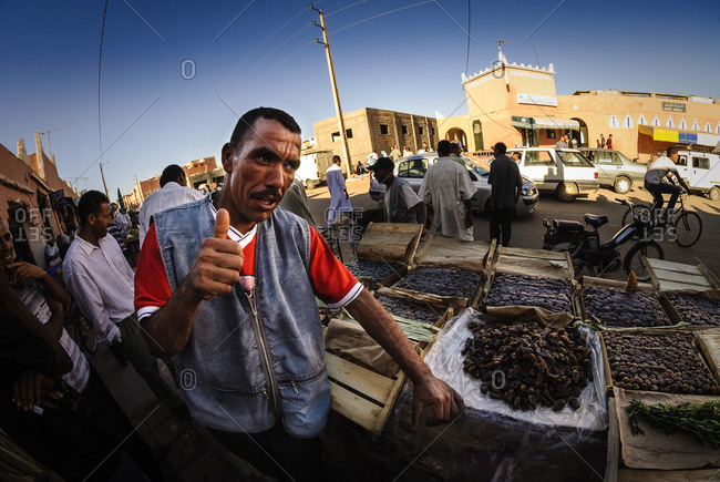 Morocco - August 19, 2010: Man selling dates in Moroccan market