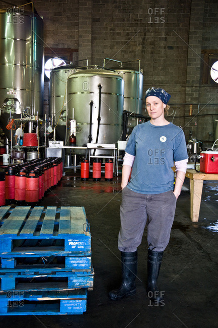 A worker stands in front of brewing tanks at a New Orleans brewery
