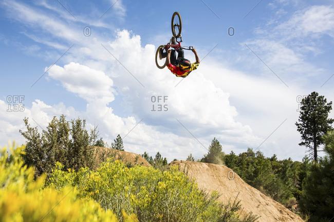 Bend, Oregon, USA - August 11, 2014: A freestyle biker doing a backflip