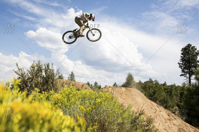 Bend, Oregon, USA - August 11, 2014: Biker midair over jump