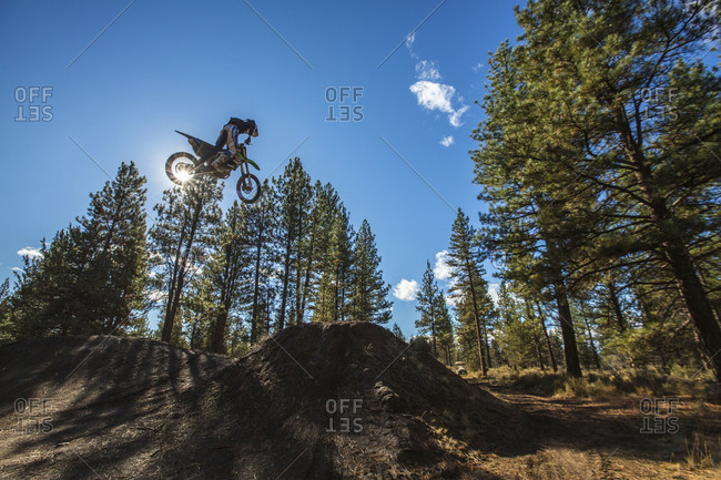 Sisters, Oregon, USA - September 25, 2014: Dirt biker high over jump