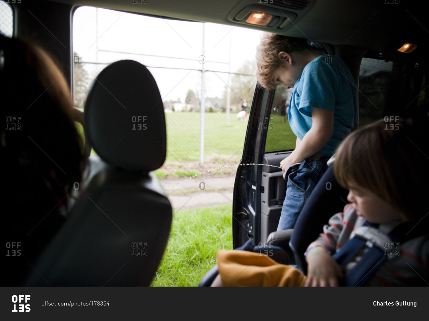 boy peeing out of a car stock photo offset. Black Bedroom Furniture Sets. Home Design Ideas
