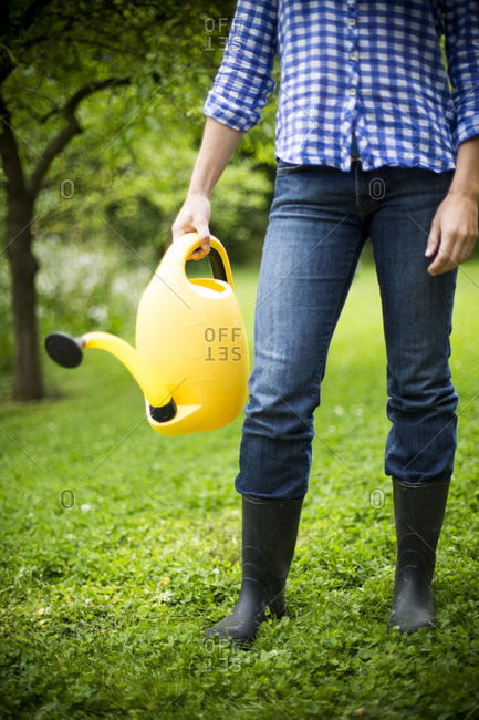 Woman holding watering can - Offset
