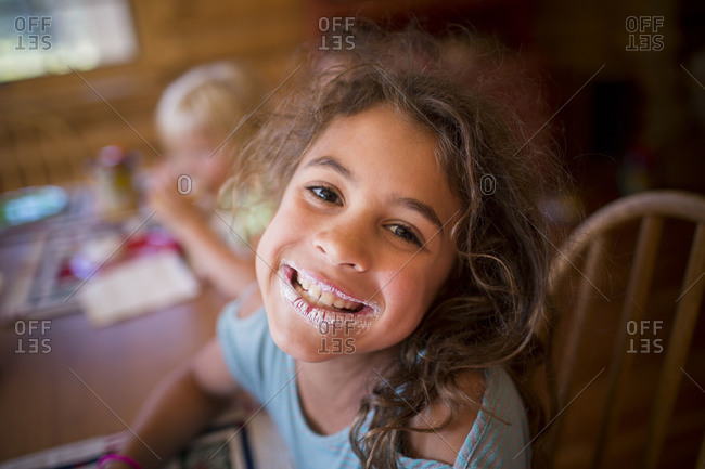Girl with food on her mouth