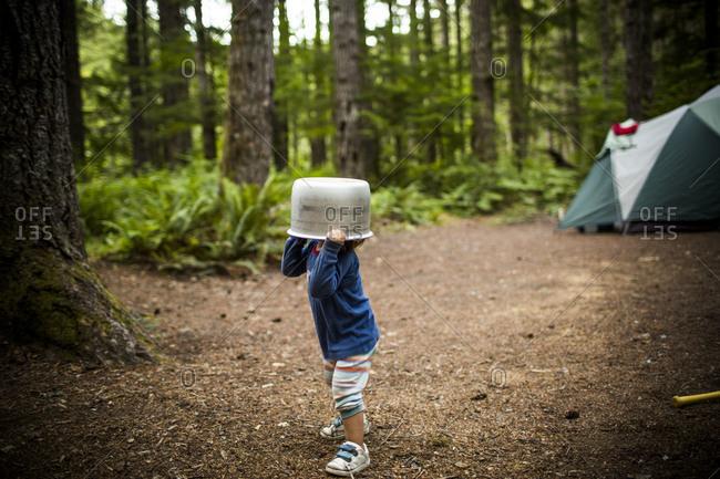 Boy wearing a pot on his head