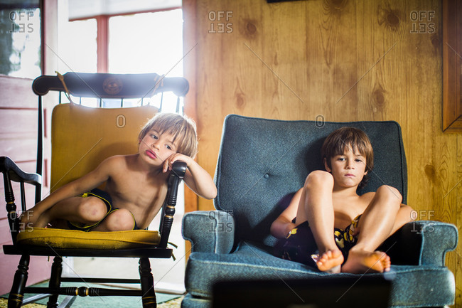 Boys sitting in a living room