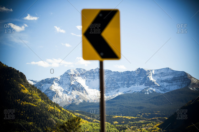 Landscape of a snowy mountain ridge with a sign