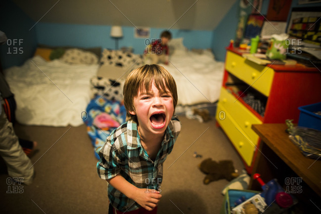 Boy crying in his bedroom