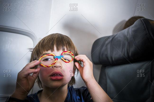 Boy goofing around on an airplane