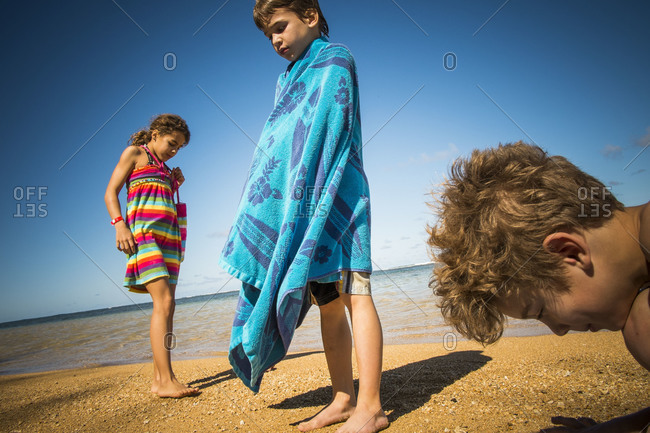 Children hanging out at a beach