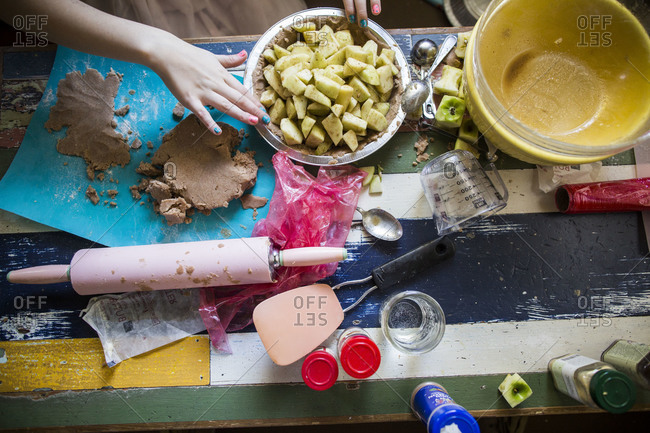 Girl making an apple pie