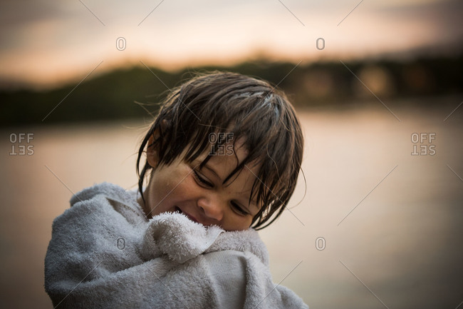 Young boy wrapped in a towel
