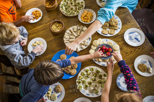 Children eating appetizers at a table