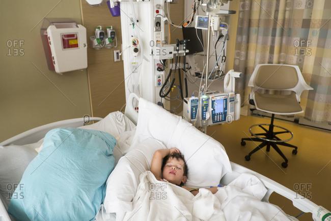 Boy sleeping in a hospital bed