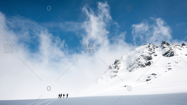 A group of skiers near the summit of Rosablanche, on the second stage of the Chamonix-Zermatt Haute Route, Switzerland