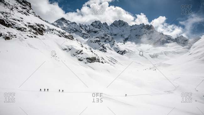 A group of skiers comes down from the Vignettes Hut and starts the long climb up to the Bertol Hut, Switzerland