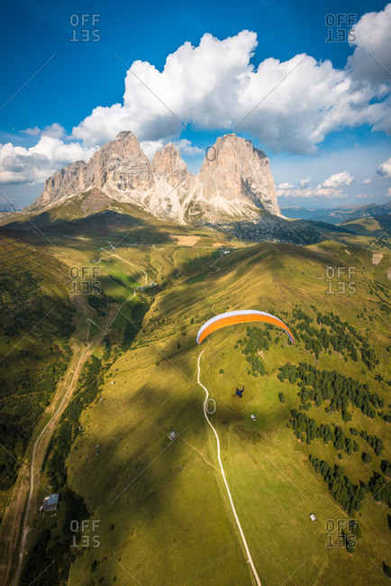 Paragliders in the busy Val di Fassa, Trentino. In the background, the Langkofel group, Italy