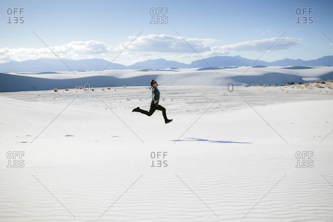 Man running in White Sands National Monument