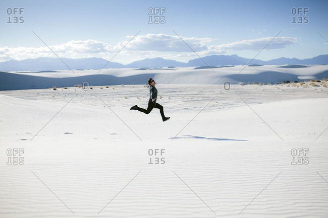 Man running in White Sands National Monument