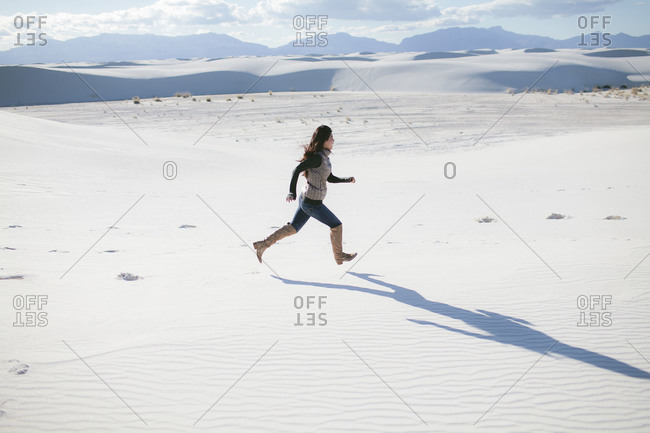 Woman running in White Sands National Monument