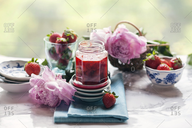 Homemade strawberry jam on a kitchen counter