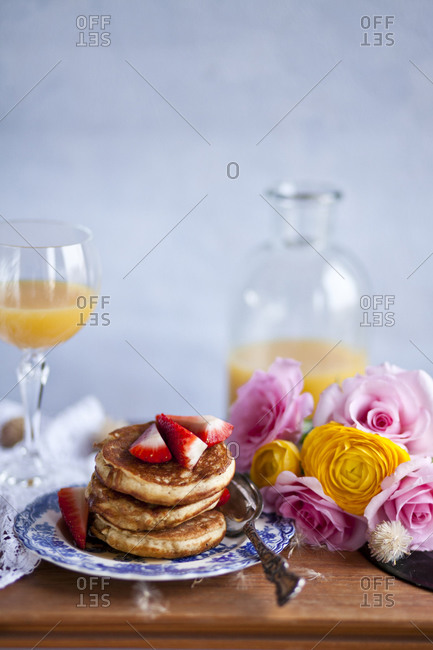 Gluten free american pancakes with maple syrup and strawberries
