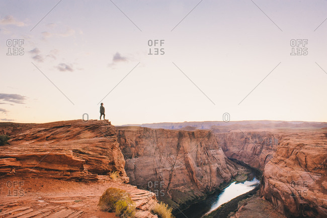 Woman standing on edge of canyon cliff