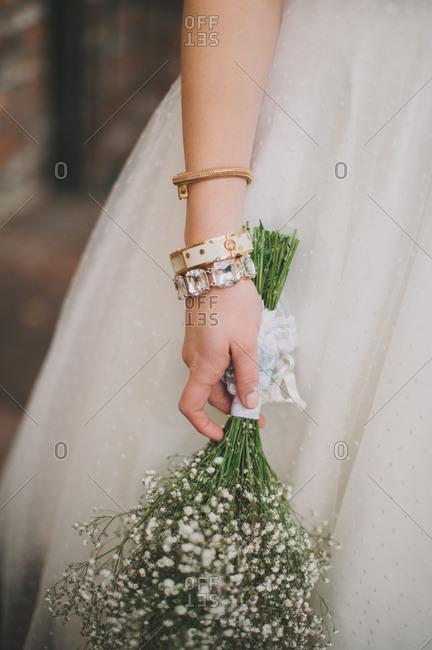 Bride holding baby breath bouquet