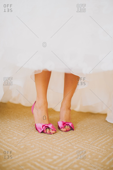 Bride lifting dress to show footwear