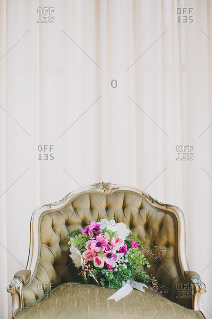 Wedding bouquet in a baroque armchair
