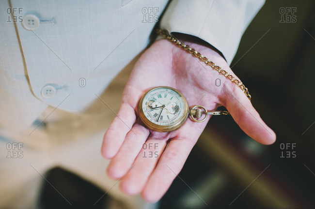 Groom checking time on pocket watch