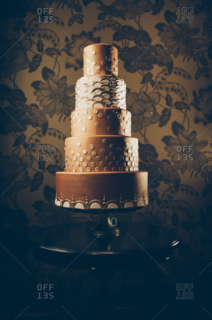 Wedding cake in front of wallpaper