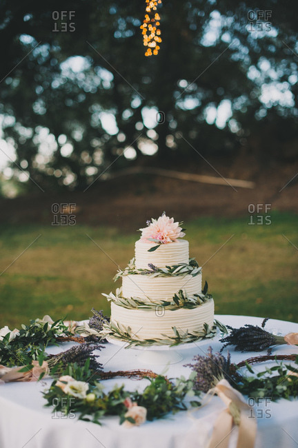 Wedding cake and flowers outdoors