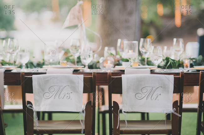 Chairs for the bride and groom at a wedding reception