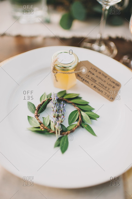 Honey and wedding decoration on a plate
