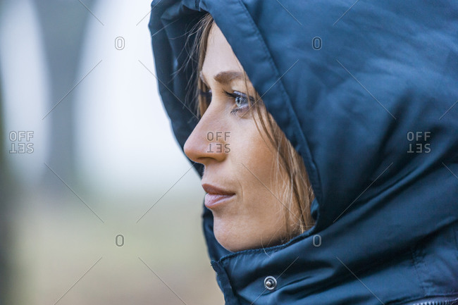 Woman with blue hood, close-up