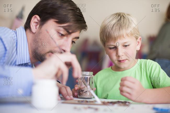 Teacher and boy in art class