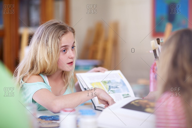 Girl with book in art class