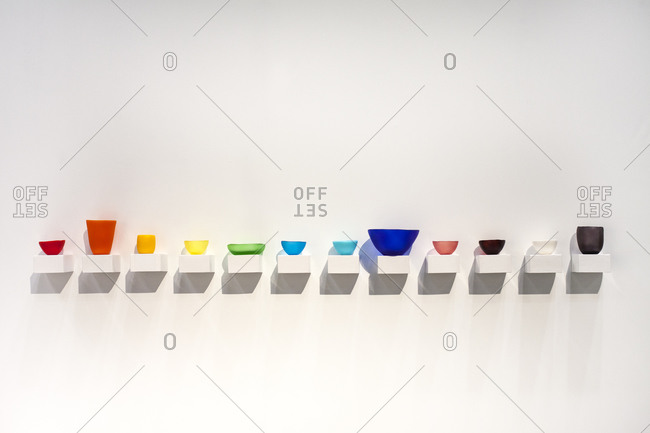 Colorful glassware on shelves