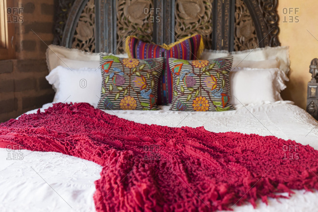 Cushions on a bed in a bohemian style home