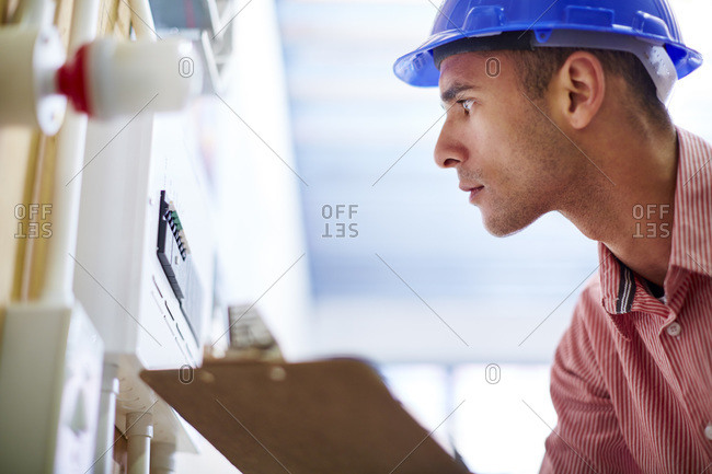 Electrician looking at distribution board