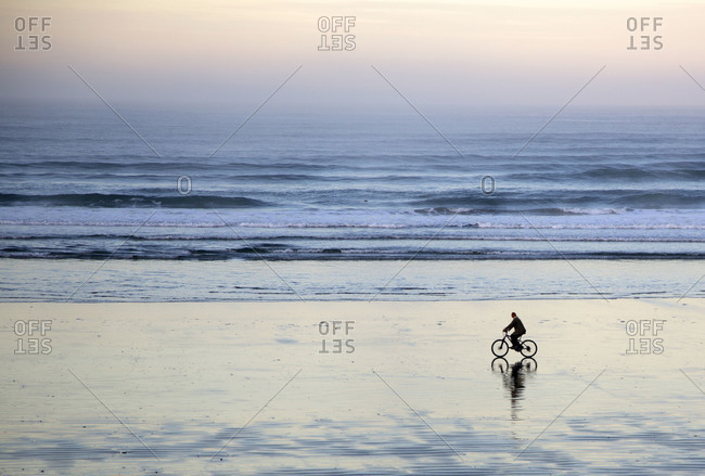 Cyclist on the beach