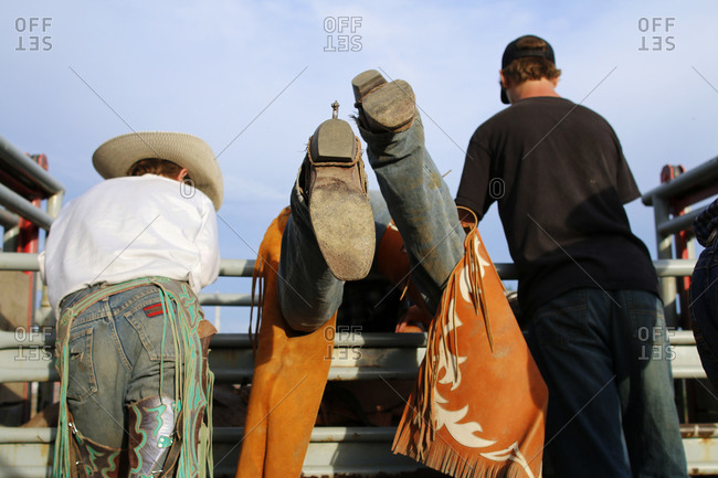 Rodeo cowboys get their horses ready to ride at a small town rodeo in Nanton, Alberta