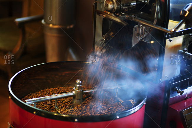 Coffee beans pouring out of a roasting machine